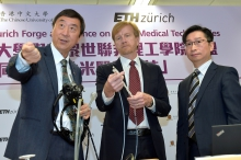 Prof. Joseph SUNG (Left) introduces the operation of the new magnetic guided endoscope.