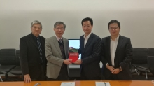 Prof. Walter Ho (1st left) and Prof. Raymond Yeung (2nd left) present Prof. Yeung's book to Mr. Foster Wu (2nd right).