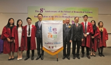 Prof. Francis CHAN, Dean of the Faculty of Medicine at CUHK (4th left), presents a flag to Prof. Wai-Yee CHAN, Director of the School of Biomedical Sciences (5th right); Prof. Kwok-Pui FUNG, Programme Director of BSc in Biomedical Sciences Programme (4th right) and student representatives, representing the official inauguration of the BSc in Biomedical Sciences Programme.