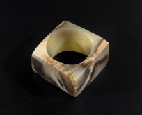 Jade cong Acc. no. 2017.0072  Pale green jade with caramel-coloured striations was common raw material of Qijia jades. Jade cong of Qijia culture had a large circular hole in the centre and thin walls with a slightly convex surface, unlike that of Liangzhu culture.