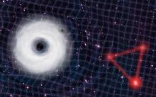 An ultralight bosonic cloud around a massive black hole orbited by a small black hole emitting gravitational waves. (Artistic illustration by Antonio Mati.)