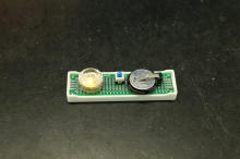 LED light powered by a molecular crowding battery prototype.