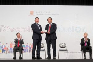 Professor Rocky Tuan, Vice-Chancellor and President of CUHK (right, front row) presents a souvenir to Mr. Ricky Chu, Chairperson of EOC.
