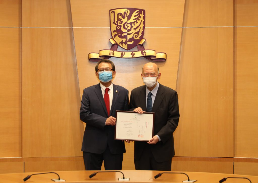 Professor Rocky S. Tuan (left), Vice-Chancellor and President of CUHK presents an appointment certificate of honorary professorship to Dr. the Honourable Geoffrey Ma (right).