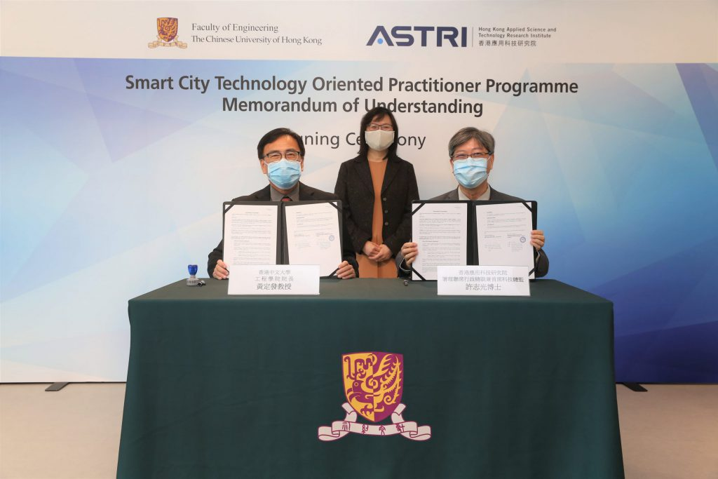 Witnessed by Ms Rebecca Pun, JP, Commissioner of Innovation and Technology (centre); Dr Lucas Hui, Acting Co-CEO cum Chief Technology Officer, ASTRI (right); and Prof Martin D. F. Wong, Dean, Faculty of Engineering, CUHK (left) sign the MOU for Smart City Technology Oriented Practitioner Programme.