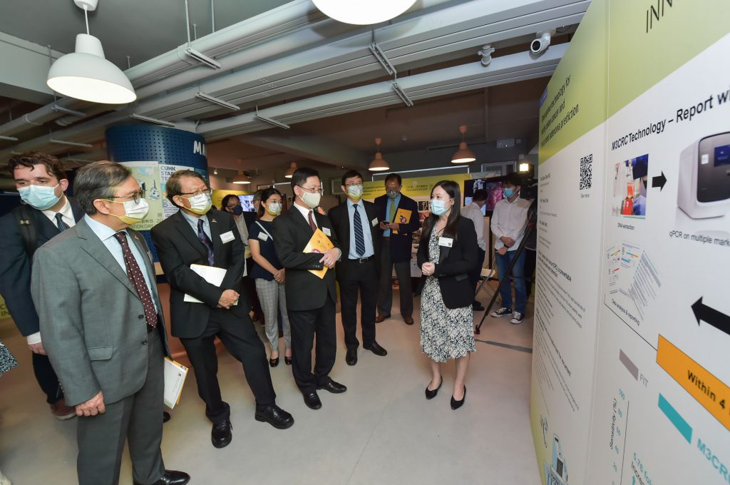 Mr. Alfred SIT, Secretary for Innovation and Technology, tours the exhibition booths hosted by CUHK at its Innovation Day.