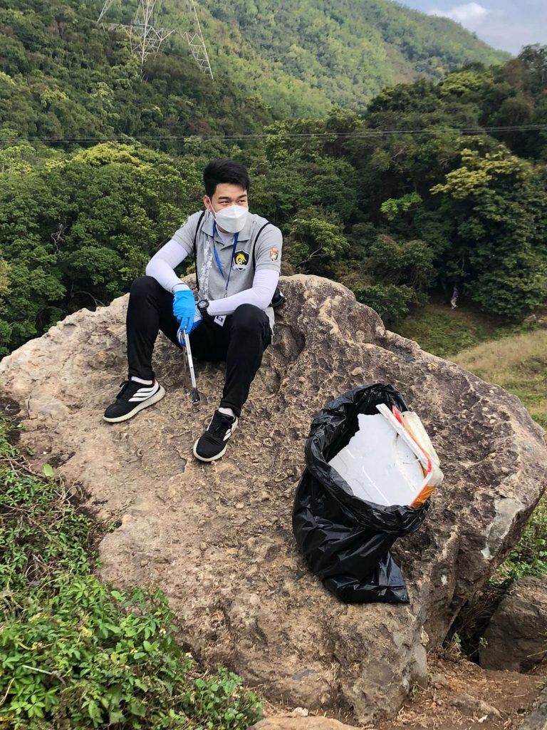 Steve Lau collects garbage in the countryside.