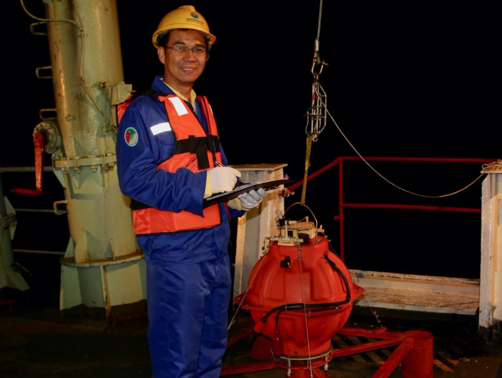 Professor Hongfeng Yang with an Ocean Bottom Seismometer during the first China-Pakistan Joint Expedition in 2018 to investigate potential earthquakes and tsunami along the Makran Trench in the Indian Ocean.